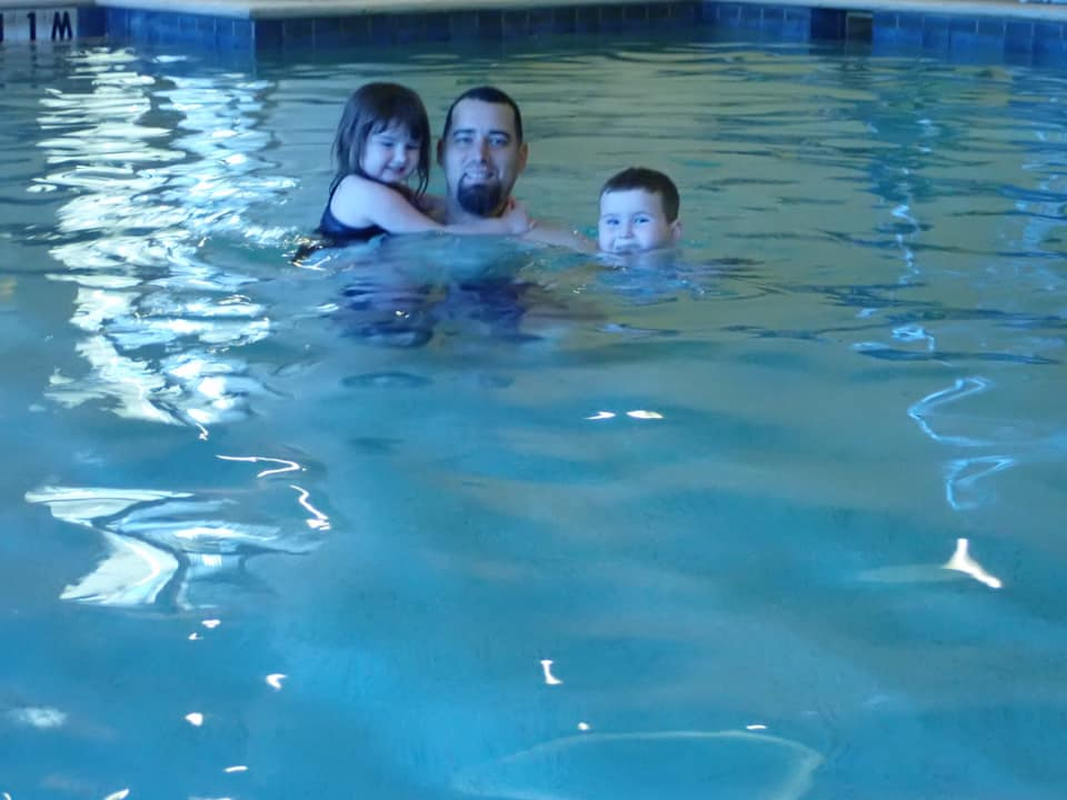 Dad with two kids swimming in the pool at the Gaylord Texan in Texas. | Christmas at the Gaylord Texan Hotel