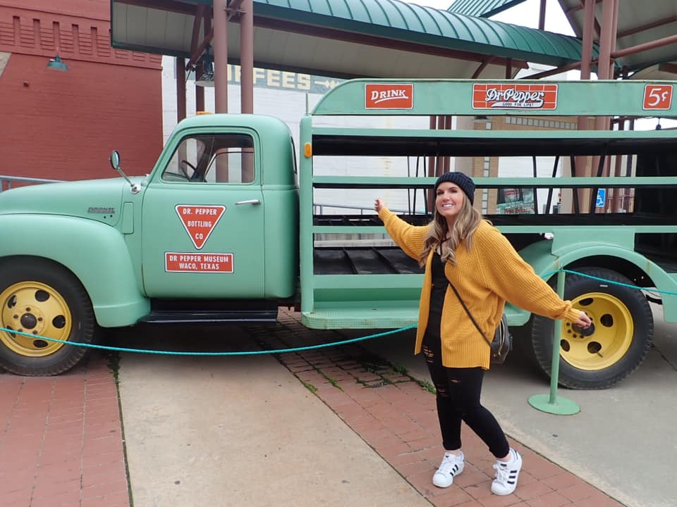 Woman posing with truck outside the Dr. Pepper Museum in Waco. | Waco, TX; Birthday Weekend in Magnolia