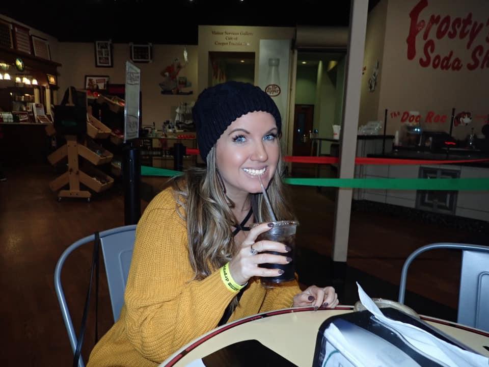 Woman drinking soda inside the Dr. Pepper Museum in Waco. | Waco, TX; Birthday Weekend in Magnolia