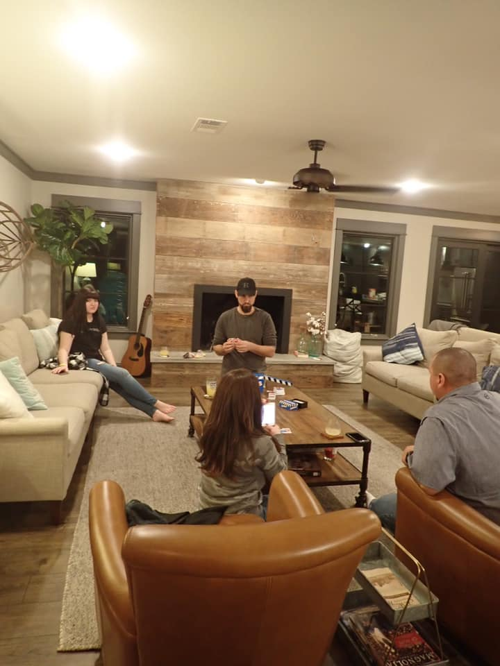 People playing games in the living room of the house featured on Fixer Upper show. | Waco, TX; Birthday Weekend in Magnolia