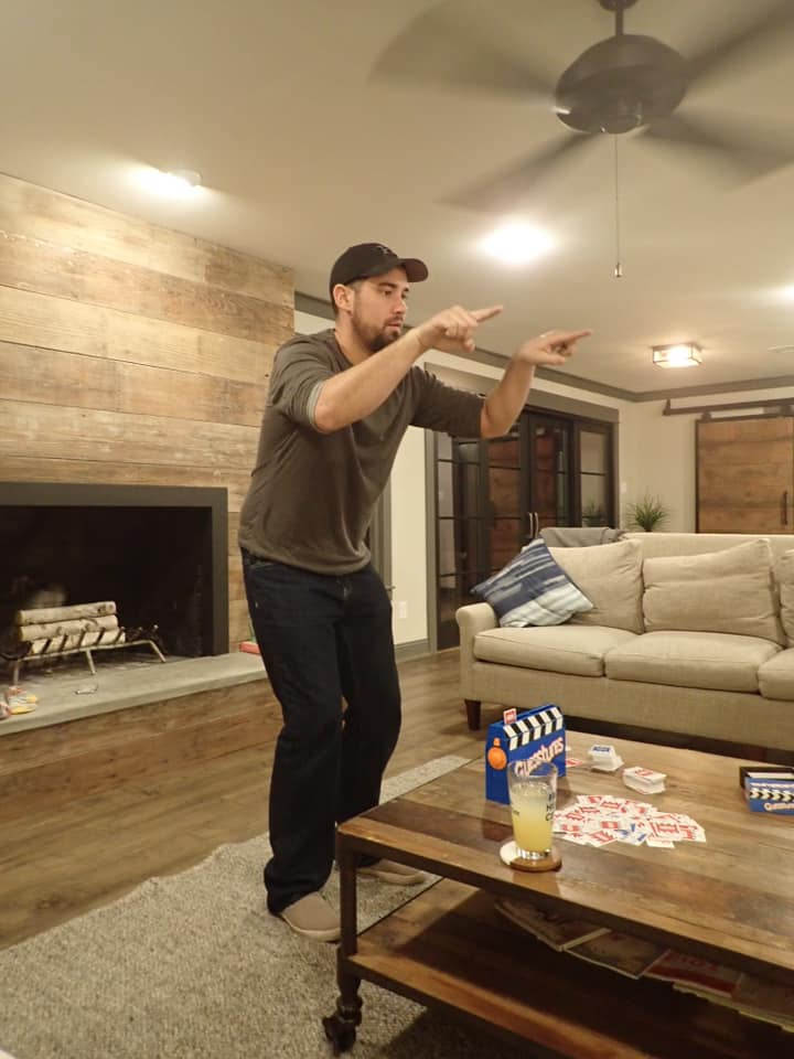 Man playing games in the living room of the house featured on Fixer Upper show. | Waco, TX; Birthday Weekend in Magnolia