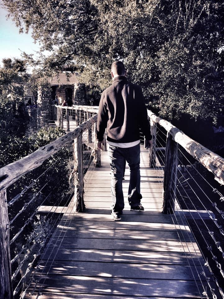 Man walking through the Japanese Tea Garden in San Antonio.   Week in San Antonio, Texas