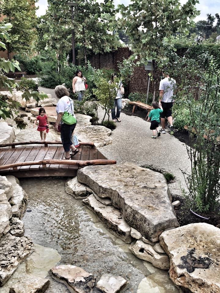 People walking around the park in San Antonio.   Week in San Antonio, Texas