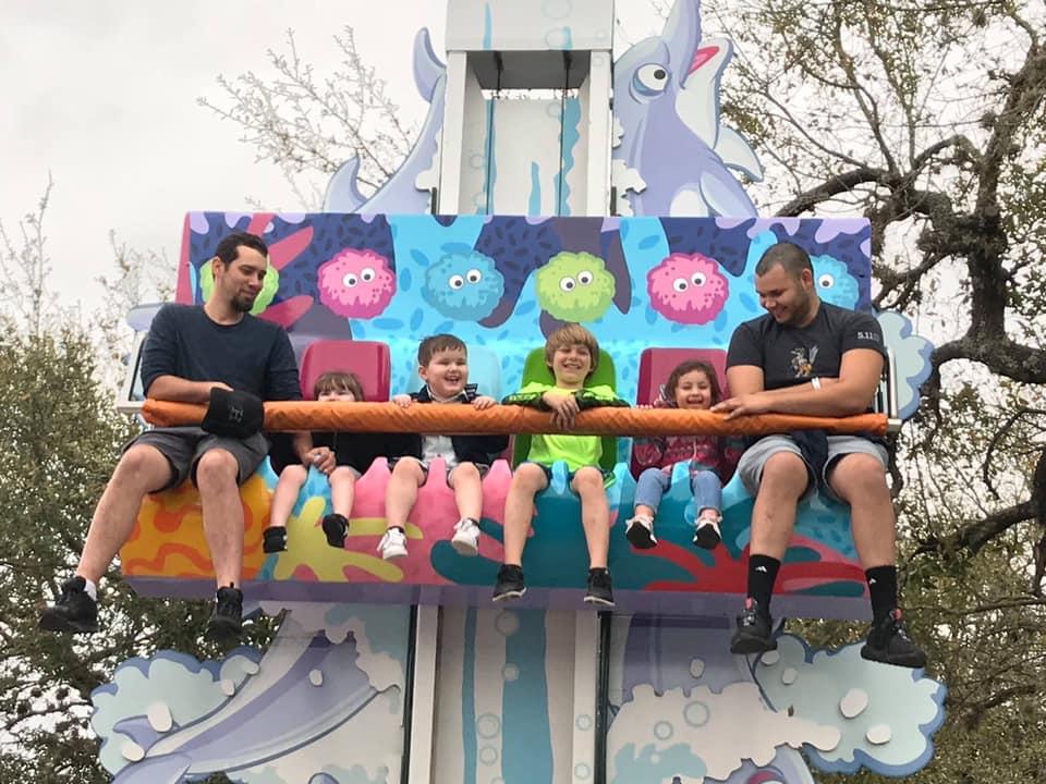 People riding kid rides at SeaWorld in San Antonio.   Week in San Antonio, Texas