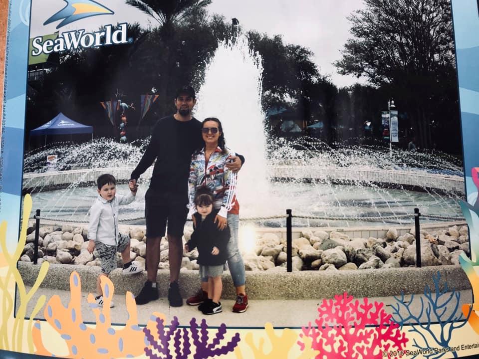 Family posing in front of water fountain at SeaWorld in San Antonio.   Week in San Antonio, Texas