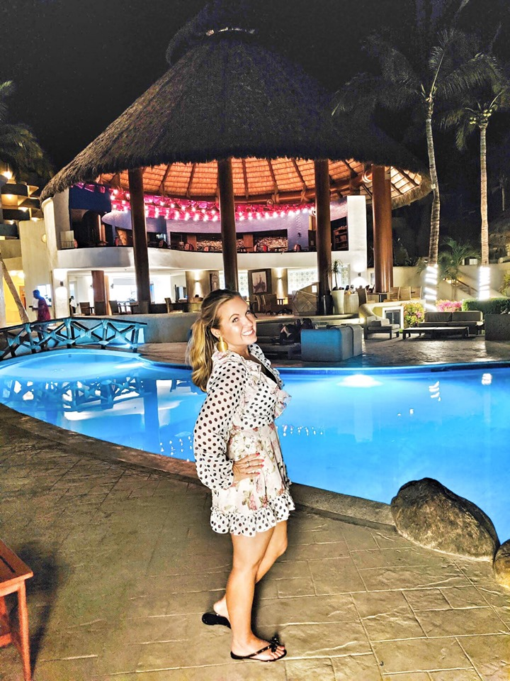 Woman standing out nightclub at Reflect Krystal in Cabo.   Cabo, Mexico- The Best All Inclusive Vacation