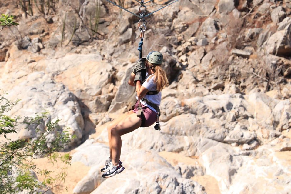 Woman ziplining in Cabo.   Cabo, Mexico- The Best All Inclusive Vacation