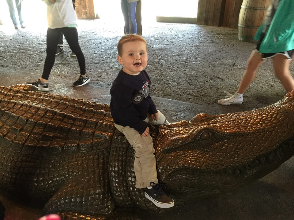Little boy riding pretend alligator at Fort Worth Zoo in Dallas.| Weekend in Dallas with Kids