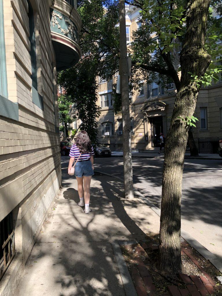 Woman walking down the streets of Boston. | Boston, Massachusetts- Adult Getaway