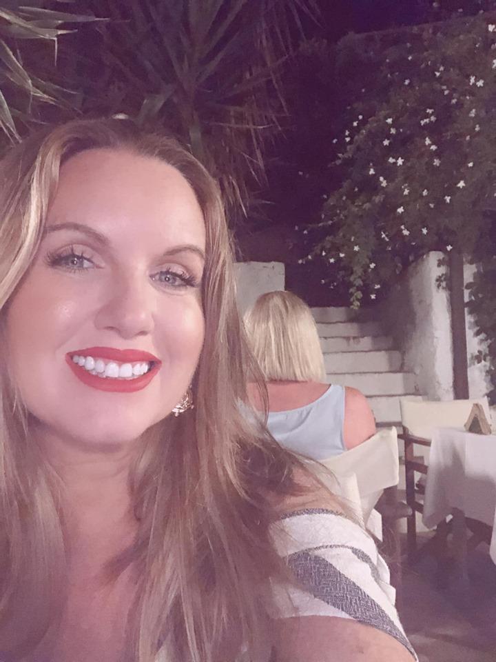 Woman taking a selfie at dinner at Anna's restaurant in Greece.| Skopelos Island, Greece- Mamma Mia Island