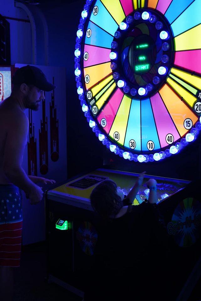 Man playing games at arcade at Epic.| Epic Waterpark in Dallas, Texas