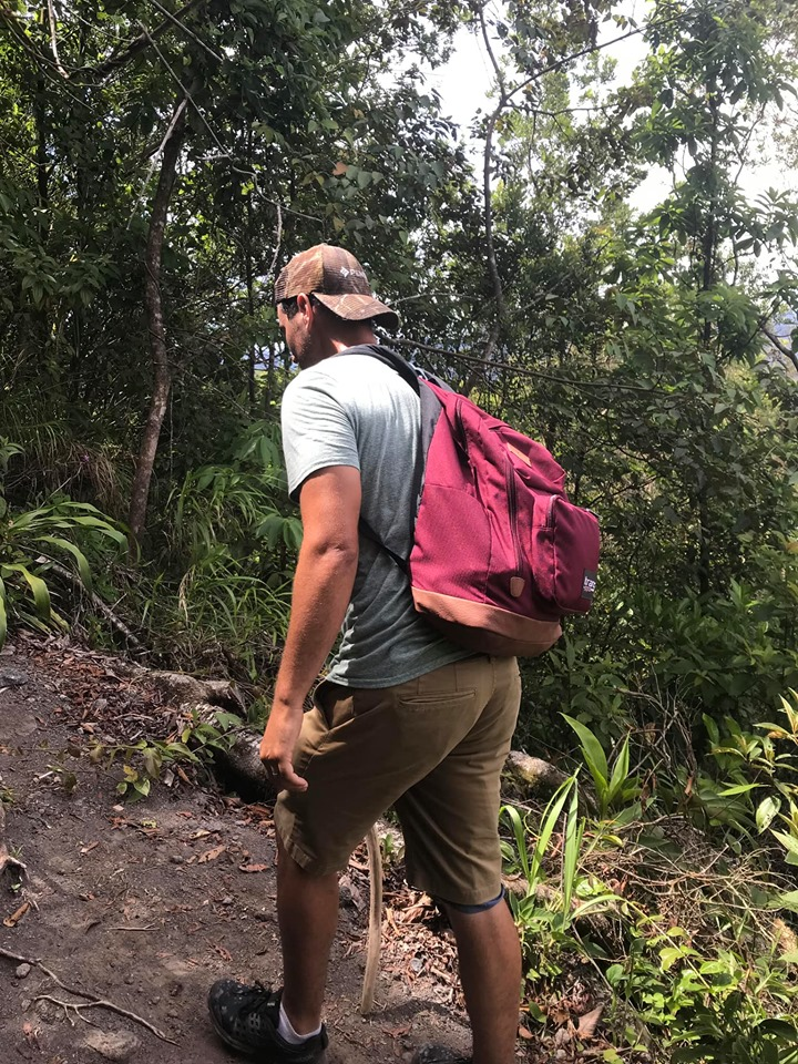 Man hiking in the jungle at the Lava Fields Walk and Ecotermales Hot Springs in Costa Rica.   Costa Rica, Arenal Volcano