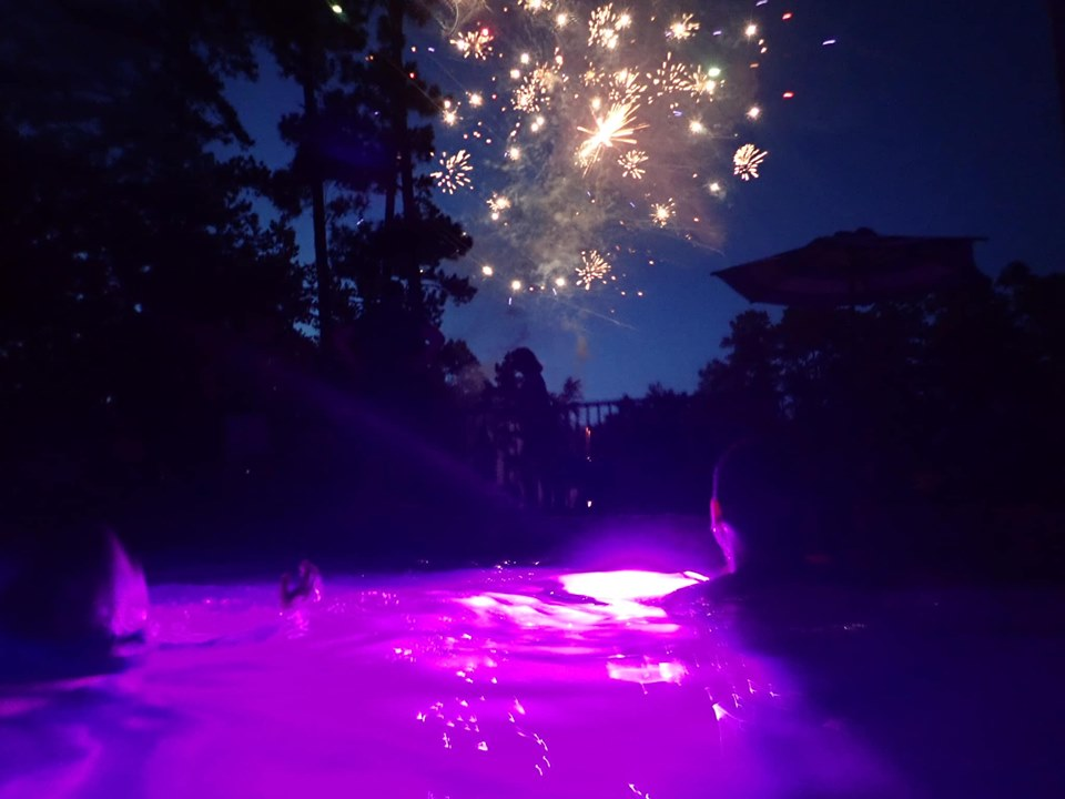 Firework show at night over the lake.| The Retreat at Artesian Lakes in Texas