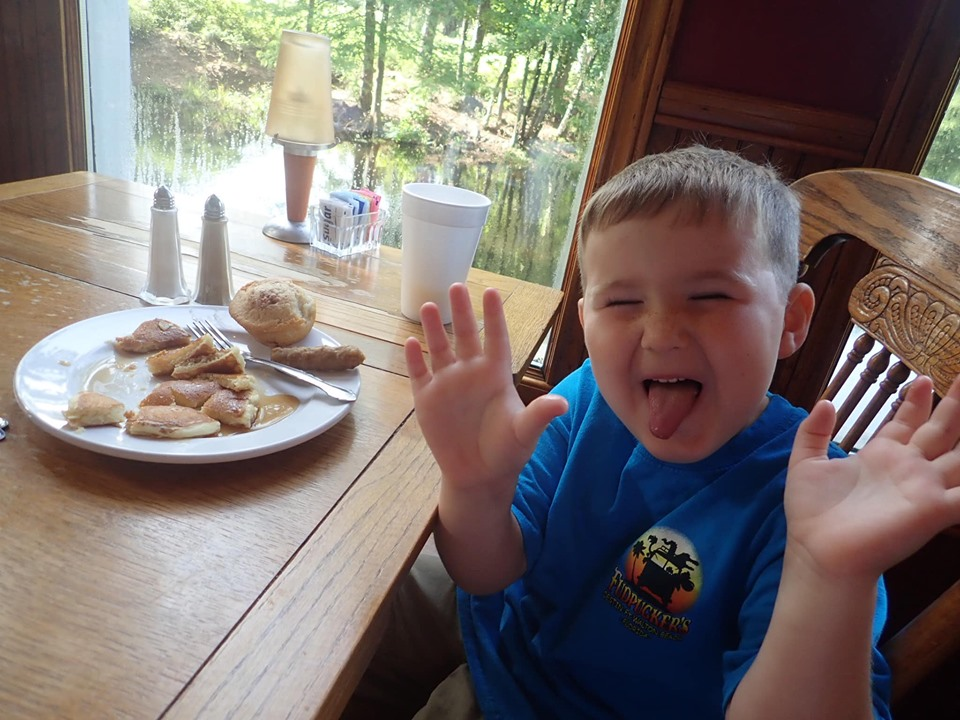Little boy eating breakfast at Hilltop Restaurant at the lake.| The Retreat at Artesian Lakes in Texas