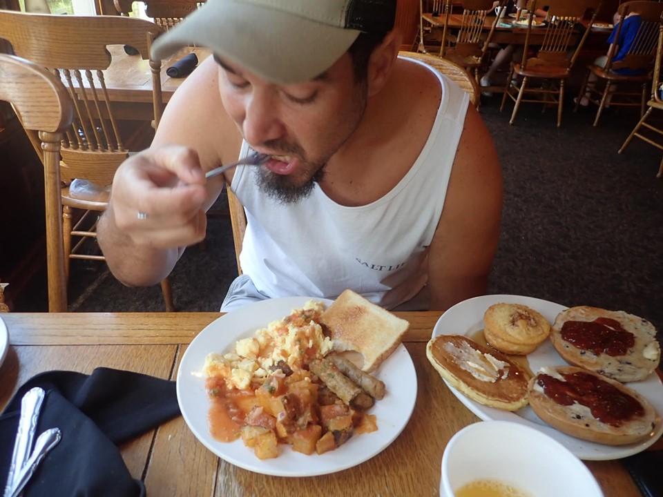Man eating breakfast at Hilltop Restaurant at the lake.| The Retreat at Artesian Lakes in Texas