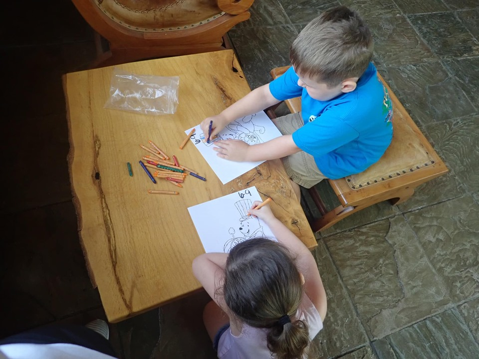Kids coloring at the table at the lake.| The Retreat at Artesian Lakes in Texas