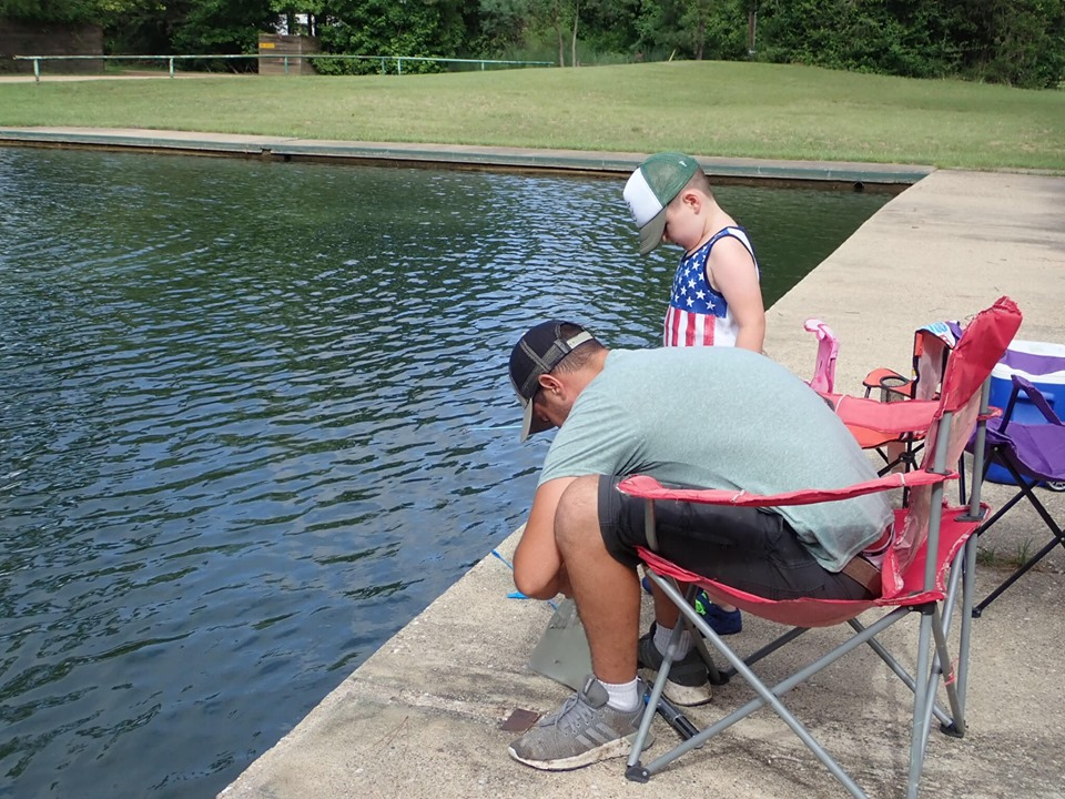Man and little boy fishing at the lake.| The Retreat at Artesian Lakes in Texas