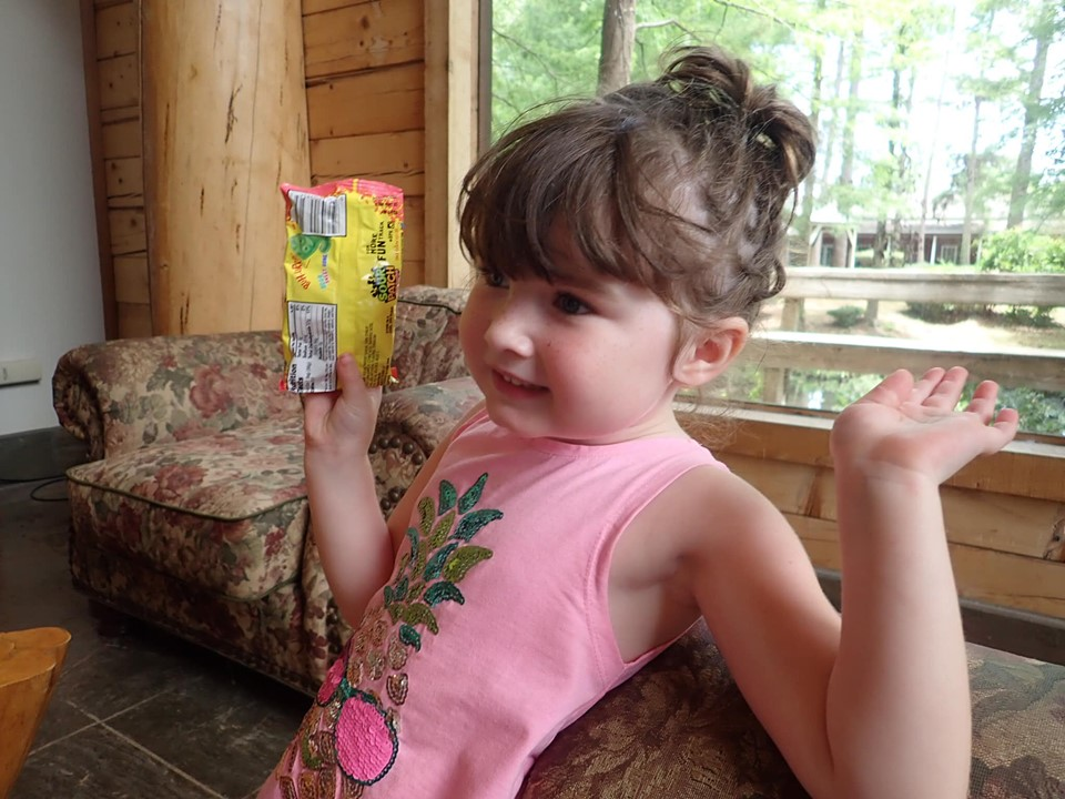 Little girl holding scavenger prize at the lake.| The Retreat at Artesian Lakes in Texas