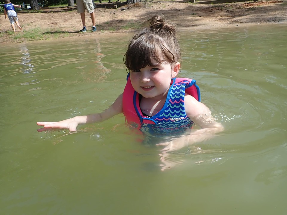 Little girl swimming in the lake.| The Retreat at Artesian Lakes in Texas