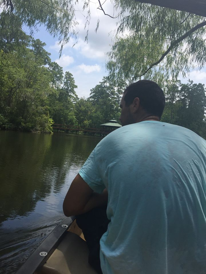 Man riding in a canoe on the lake.| The Retreat at Artesian Lakes in Texas