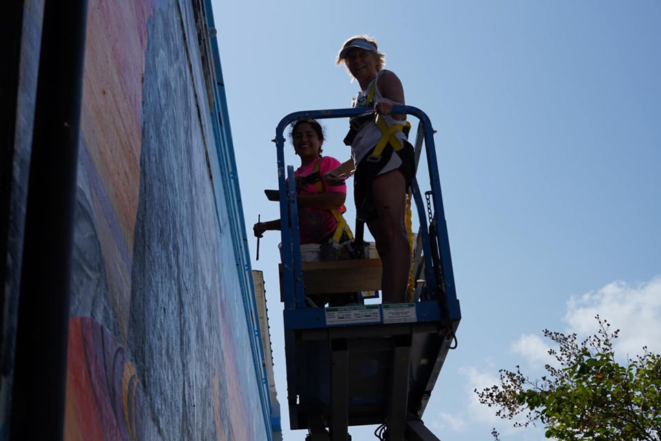 Artists working on outdoor building wall in Corpus Christi.   Corpus Christi Bachelorette Weekend