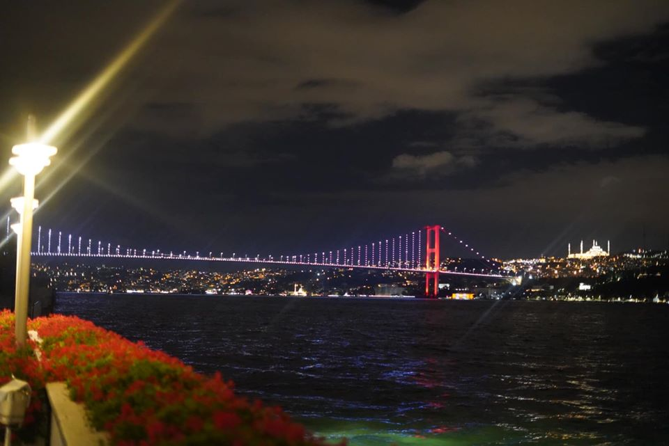 View of Asia with large lit-up bridge over the water. | Istanbul, Turkey