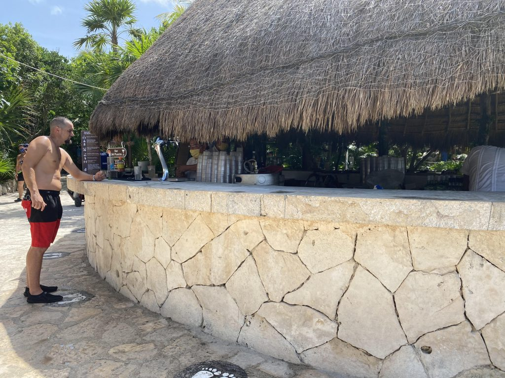 Man at the bar hut ordering a drink.| All About XeI-Ha Park in Riviera Maya