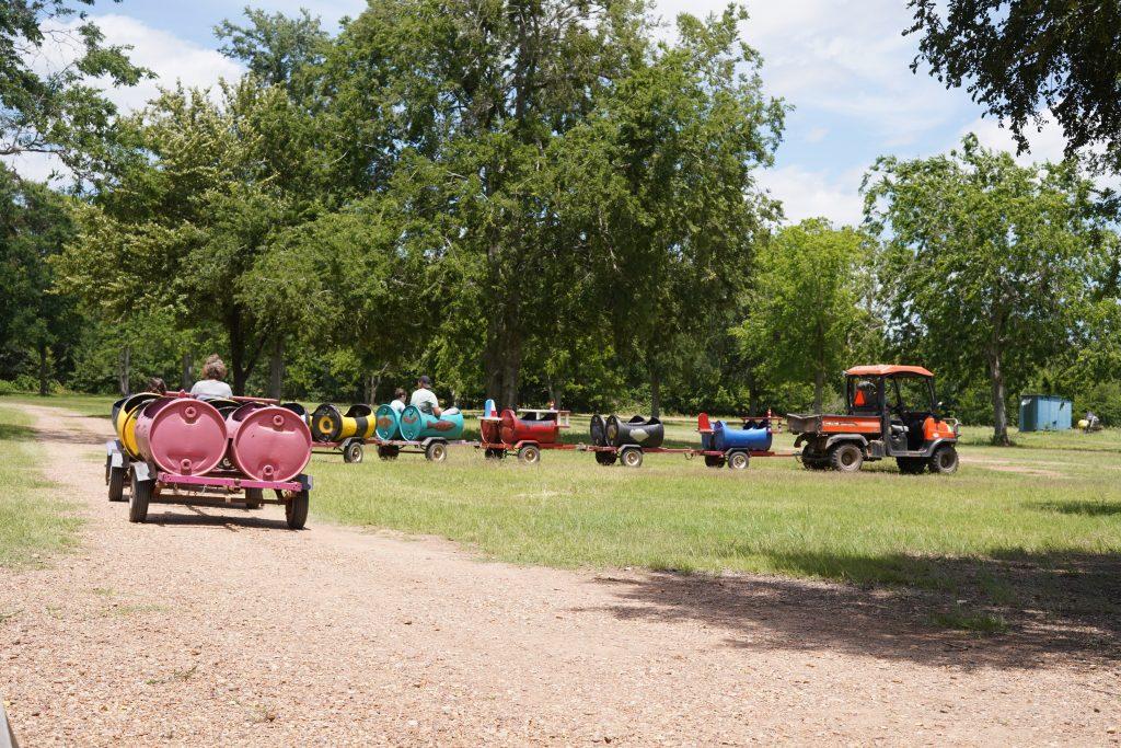 People riding the Barrel Train Ride at Blessington Fields. | Blessington Farms in Simonton, Texas