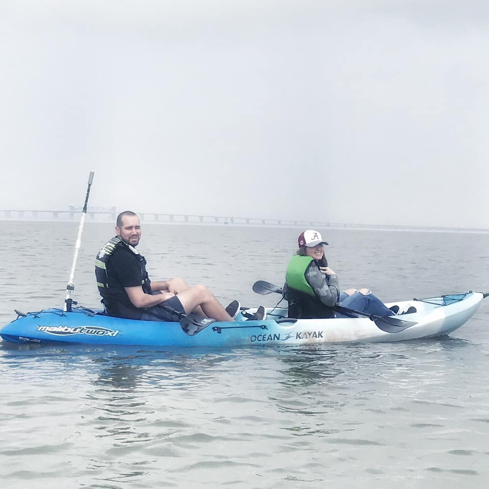 """Man and woman kayaking together in Galveston.   Adult Weekend in Galveston, Texas; on """"The Strand"""""""