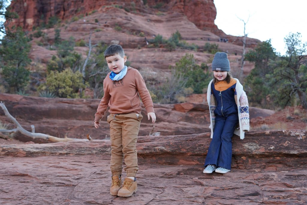 Two kids standing on Bell Rock in Arizona,| Arizona Itinerary with Kids