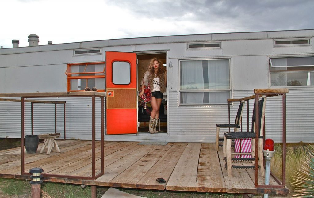 Beyonce standing inside trailor at El Cosmico in Marfa. | Marfa, Texas- Where to Stay, What to do, & What to Eat