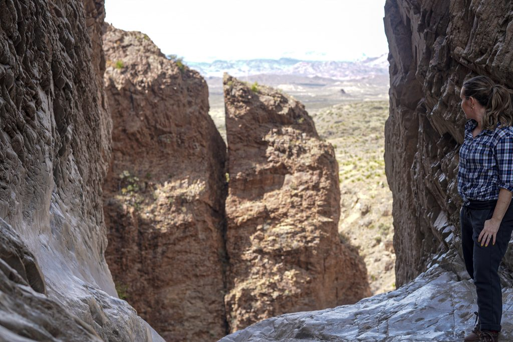 Woman standing on the rocks at Big Bend. | Big Bend National Park 1-Day Itinerary