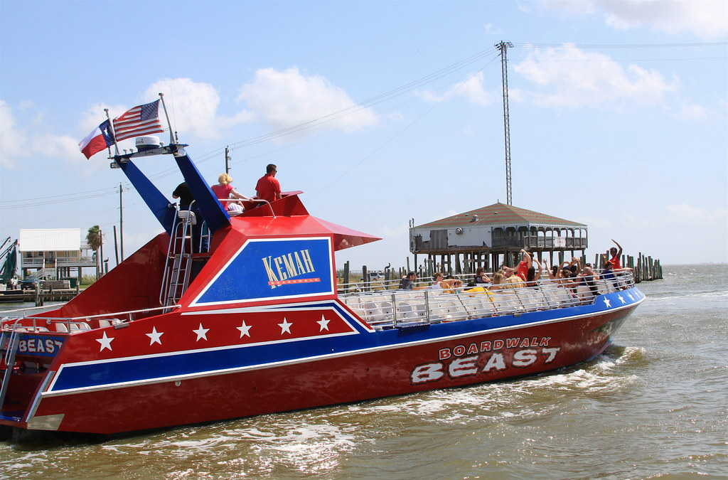 Boardwalk Beat boat with people on it at Kemah Boardwalk. | Kemah Boardwalk in Texas