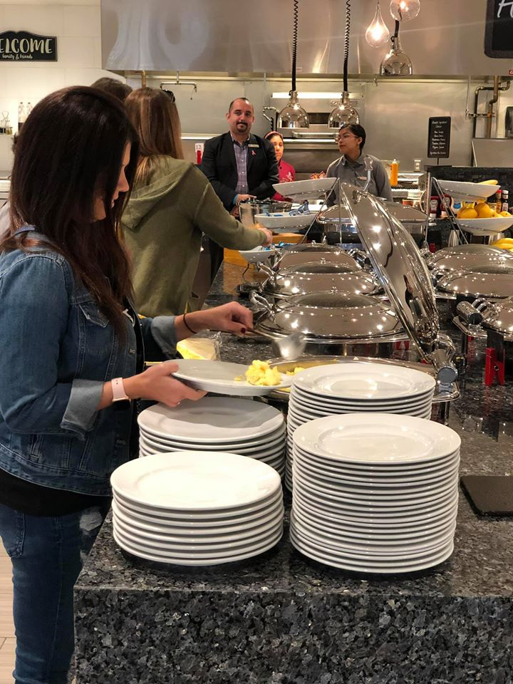 People filling their plates with free breakfast at the Embassy Suites in Hilton Woodlands.   Girls Weekend Getaway- Woodlands, TX