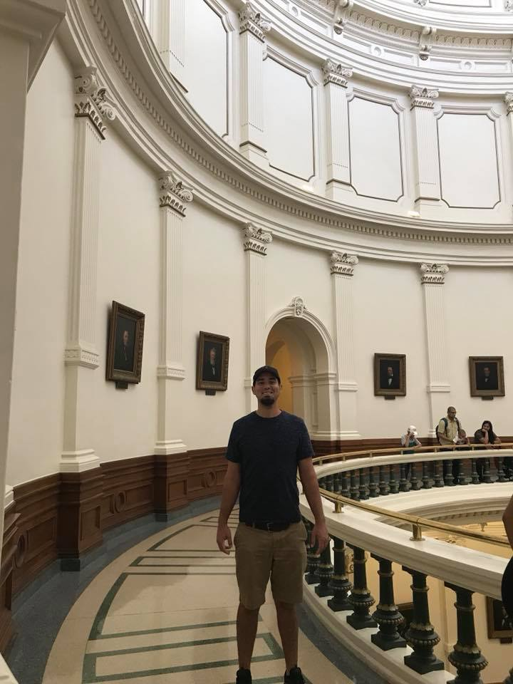 Man inside the State Capital in Austin.  Weekend Guide to Austin, Texas