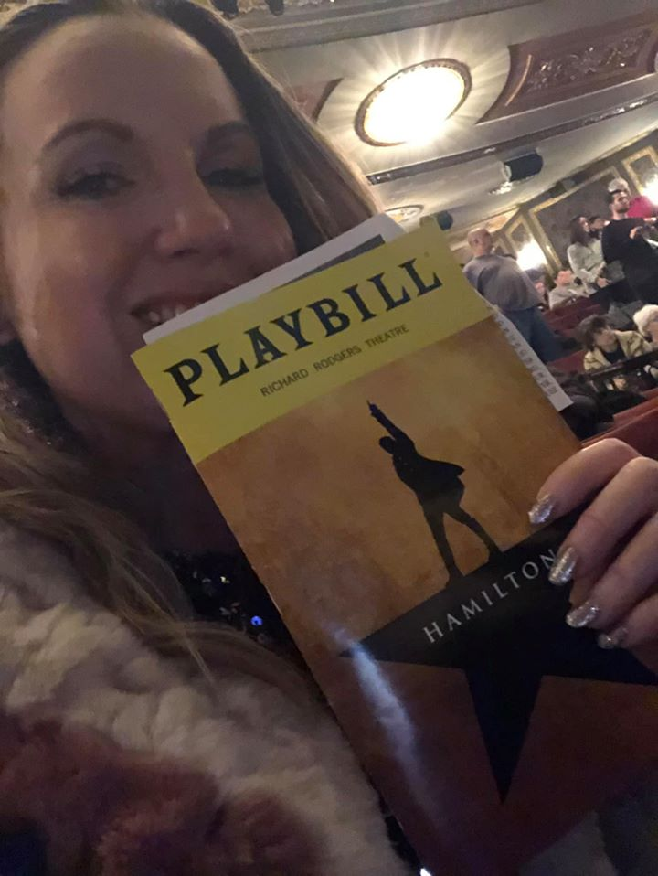 Woman holding playbill inside theater for Hamilton Broadway show.   New York City