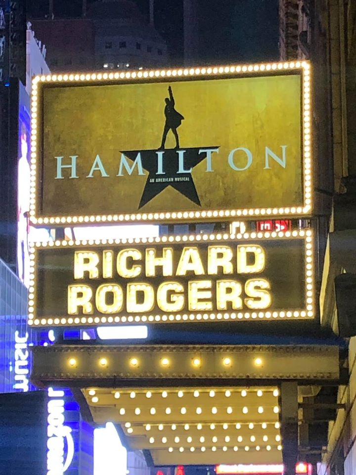 Large bright outdoor sign outside theater for Hamilton Broadway show, Richard Rodgers.   New York City