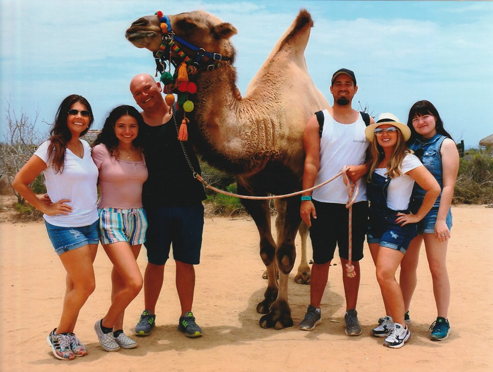 Group of people posing with a camel in Cabo.   Cabo, Mexico- The Best All Inclusive Vacation