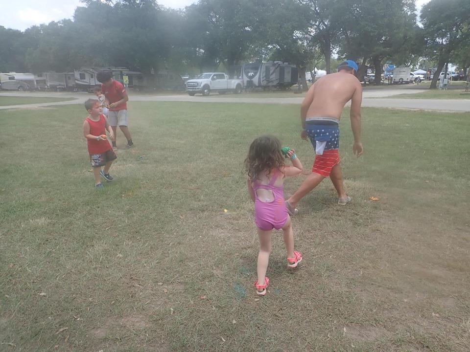 Kids having chalk wars outside at Jellystone in Texas.   Jellystone Park in Waller, Texas