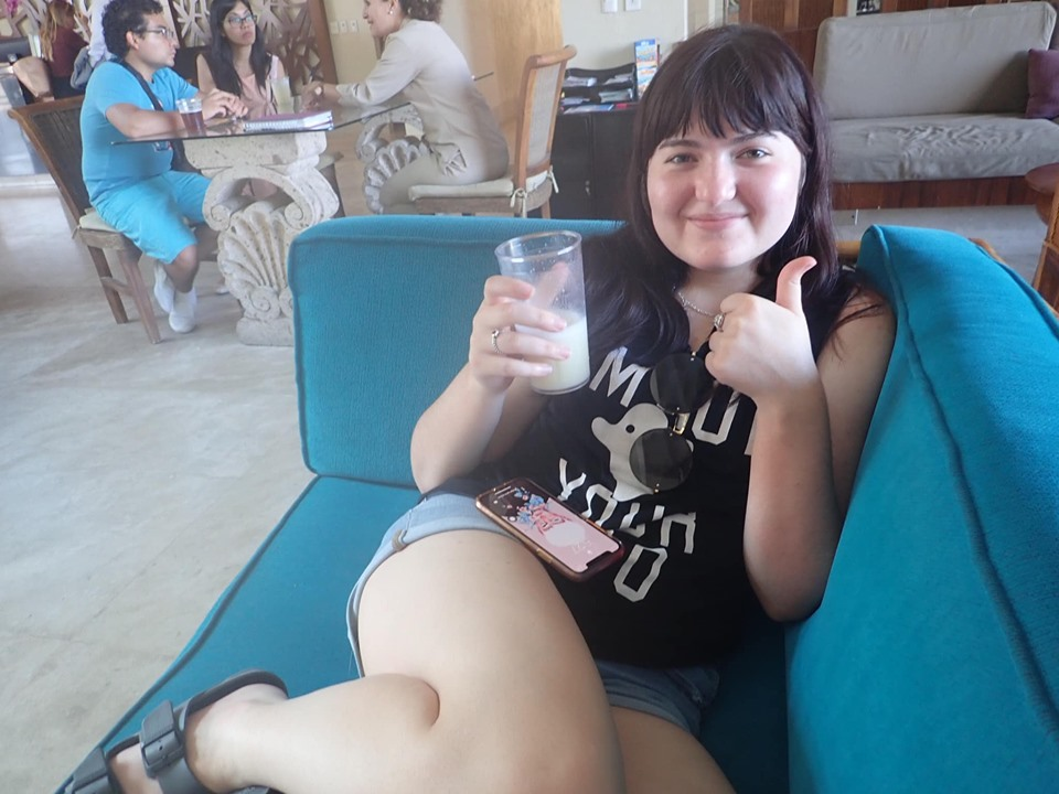 Woman drinking cocktail on the couch in the lobby at Reflect Krystal in Cabo.   Cabo, Mexico- The Best All Inclusive Vacation