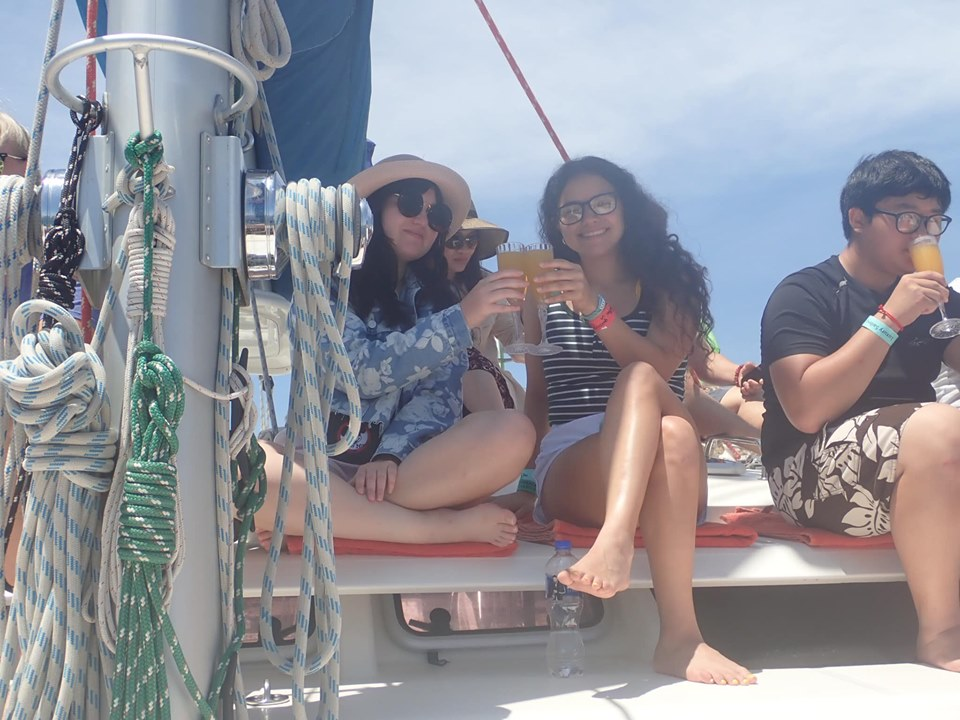 Girls toasting glasses on mimosas' on catamaran in Cabo.   Cabo, Mexico- The Best All Inclusive Vacation