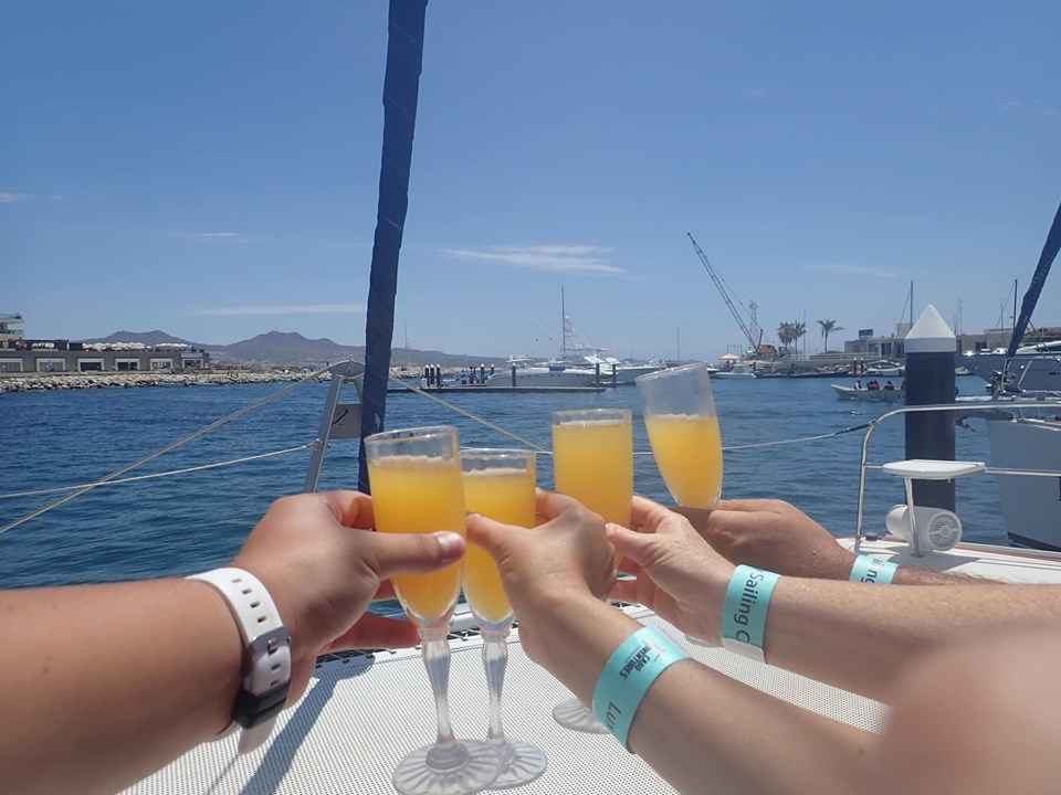 People toasting glasses on mimosas' on catamaran in Cabo.   Cabo, Mexico- The Best All Inclusive Vacation