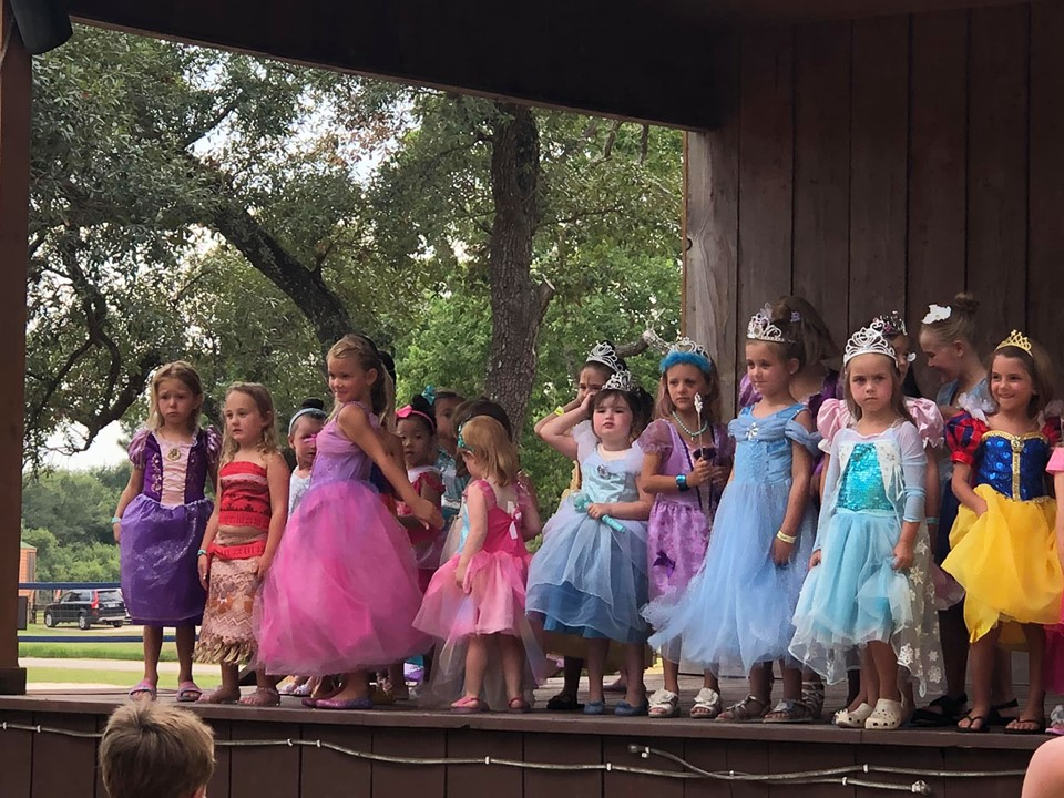 Little girls dressed up as princesses on stage at Jellystone in Texas.   Jellystone Park in Waller, Texas