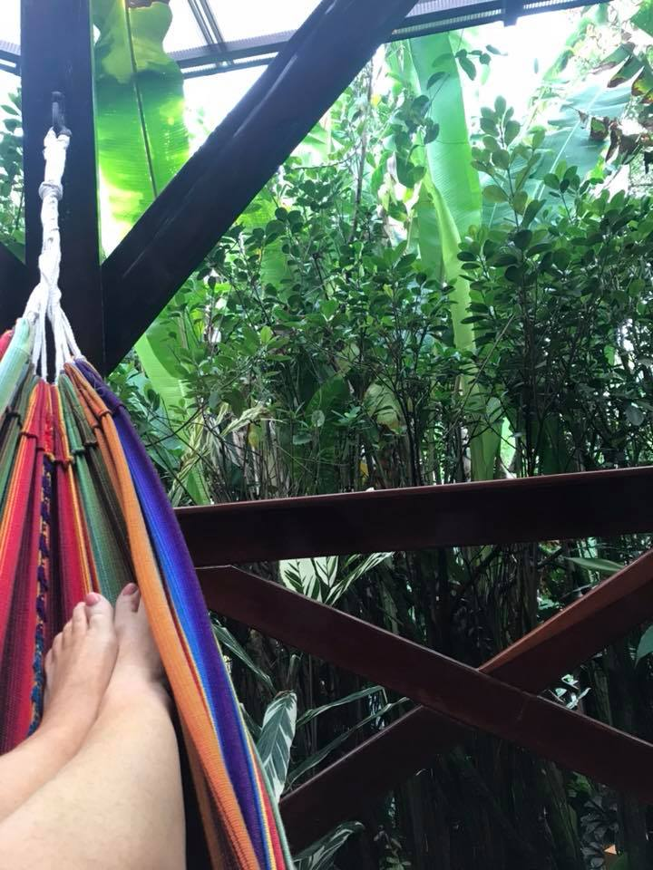Woman relaxing in a hammock at the Villas at Nayara Spa and Gardens in La Fortuna.   Costa Rica, Arenal Volcano