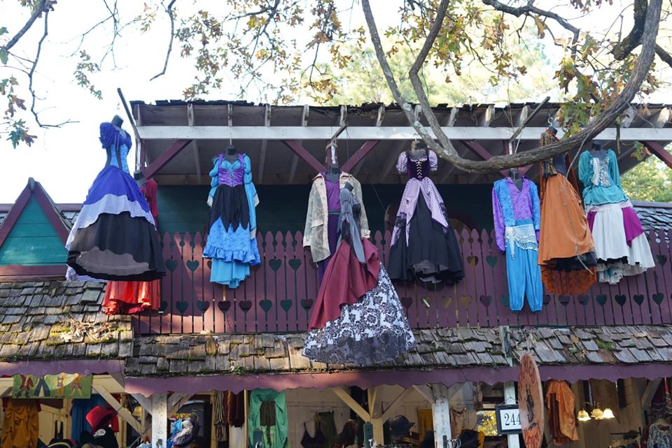 Costume store with costumes hanging from the roof. | Texas Renaissance Festival