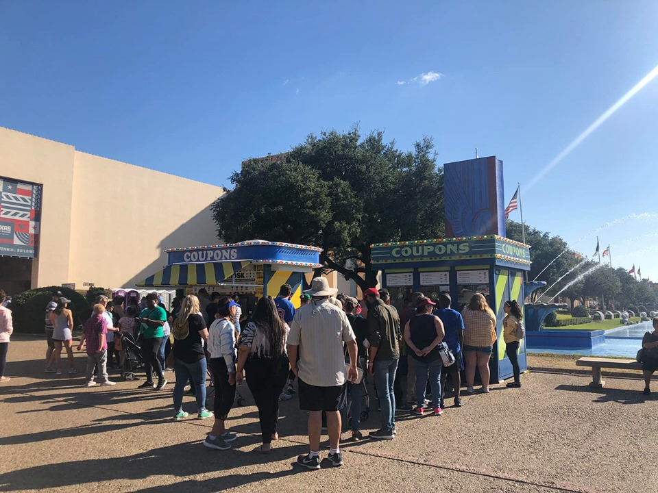 Crowd gathered around the coupon machines at the fair.| State Fair of Texas-Dallas