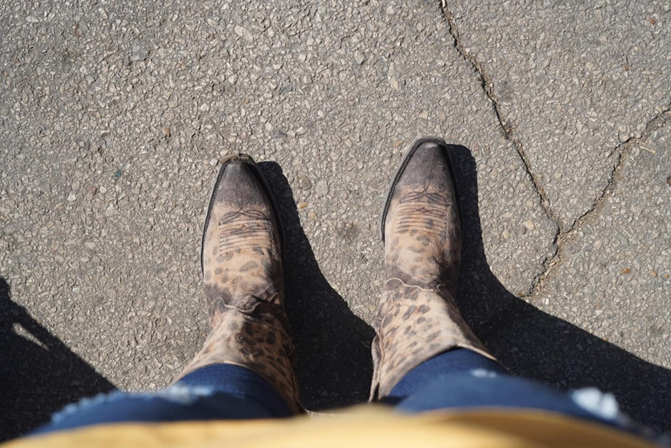 Woman wearing cowgirl boots at the fair.| State Fair of Texas-Dallas