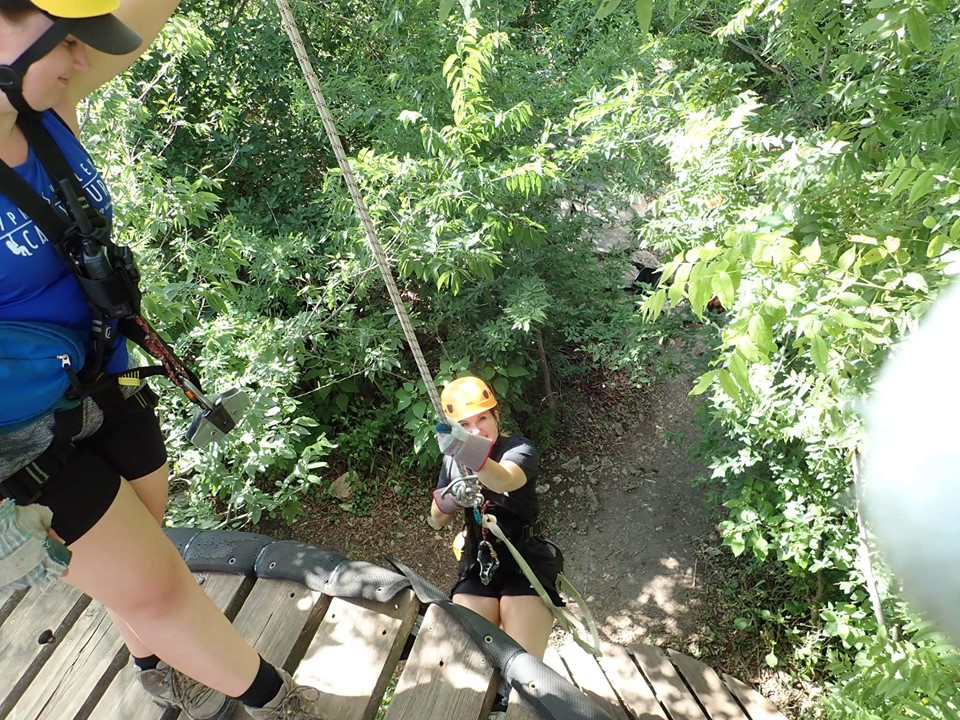 People riding a zip line at Cypress Valley. | Cypress Valley Canopy Tour in Austin, Texas