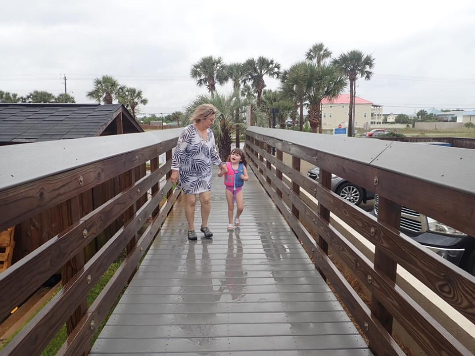 Woman walking with little girl on the boardwalk in Destin.   Destin, Florida with the Kids