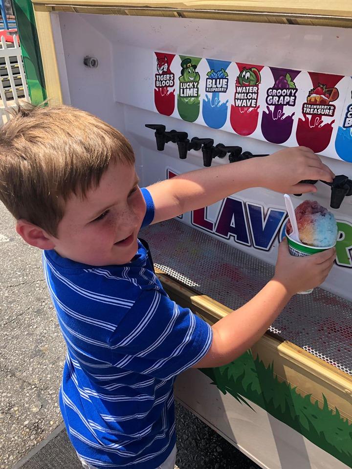 Little boy serving more Kona Ice at the Destin Harbor Boardwalk in Destin.   Destin, Florida with the Kids